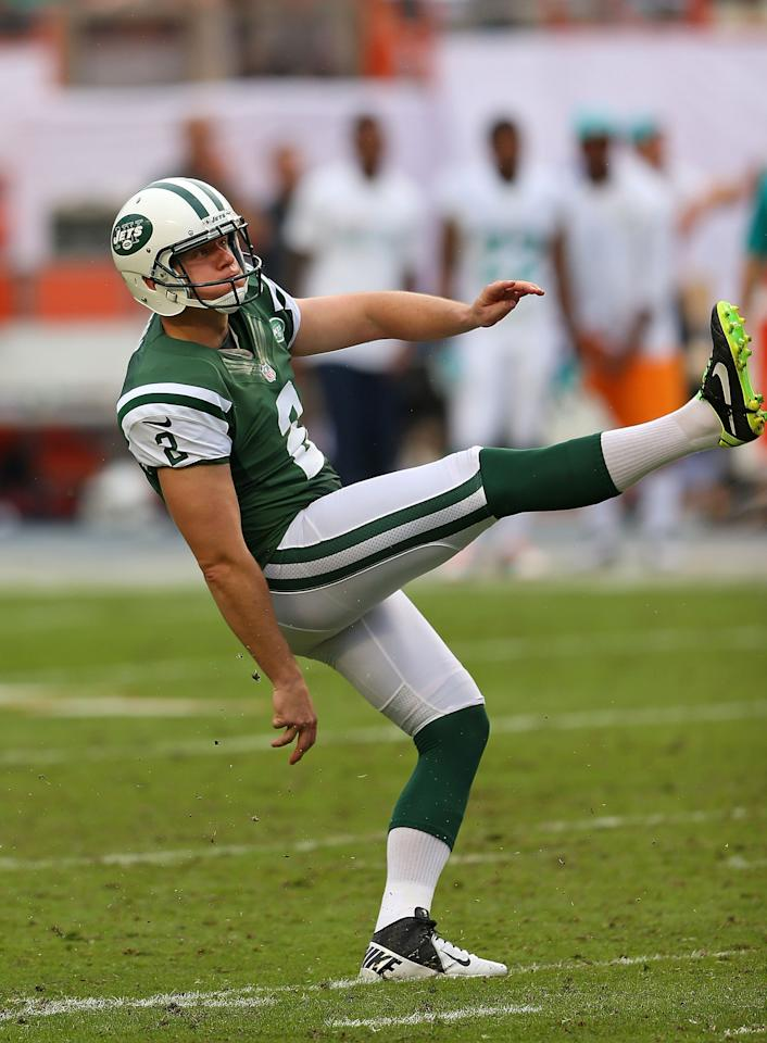 MIAMI GARDENS, FL - DECEMBER 29: Nick Folk #2 of the New York Jets kicks a field goal during a game against the Miami Dolphins at Sun Life Stadium on December 29, 2013 in Miami Gardens, Florida. (Photo by Mike Ehrmann/Getty Images)