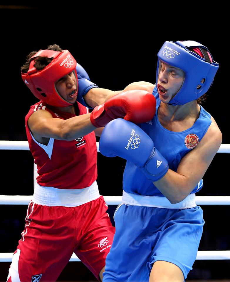 LONDON, ENGLAND - AUGUST 06:  Sofya Ochigava of Russia (Blue) competes against Alexis Pritchard (Red) of New Zealand during the Women's Light (60kg) Boxing Quarterfinals on Day 10 of the London 2012 Olympic Games at ExCeL on August 6, 2012 in London, England.  (Photo by Scott Heavey/Getty Images)