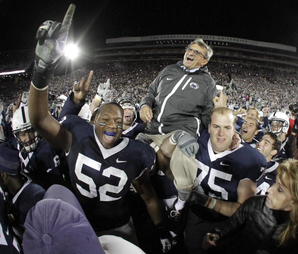 FILE - In this Nov. 6, 2010 file photo, Penn State football coach Joe Paterno is carried off the field by his players after getting his 400th collegiate win, a 38-21 victory over Northwestern, in State College, Pa. Paterno say he plans to retire at the end of the season, his long and illustrious career brought down because he failed to do all he could about an allegation of child sex abuse against a former assistant. (AP Photo/Gene J. Puskar, File)