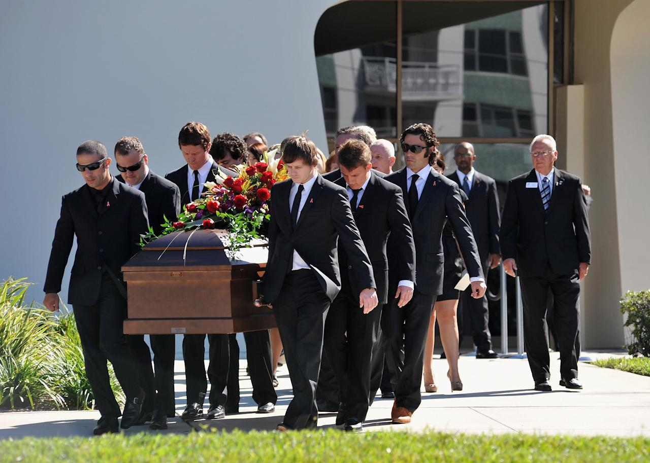 ST PETERSBURG, FL - OCTOBER 22:   Pallbearers Austen Wheldon, Elliott Wheldon, Ashley Wheldon, Dario Franchitti, Scott Dixon and Tony Kanaan carry Dan Wheldon's casket to the hearse following a memorial service at First Presbyterian Church on October 22, 2011 in St Petersburg, Florida. Wheldon, who was 33 was killed in a 15-car crash at Sunday's season-ending IndyCar race in Las Vegas.  (Photo by Tim Boyles/Getty Images)
