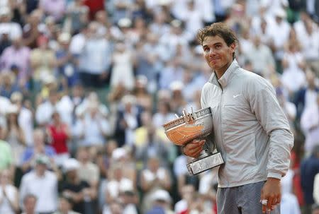 Rafael Nadal of Spain attends the trophy ceremony after defeating Novak Djokovic of Serbia during their men's singles final match to win the French Open Tennis tournament in Paris