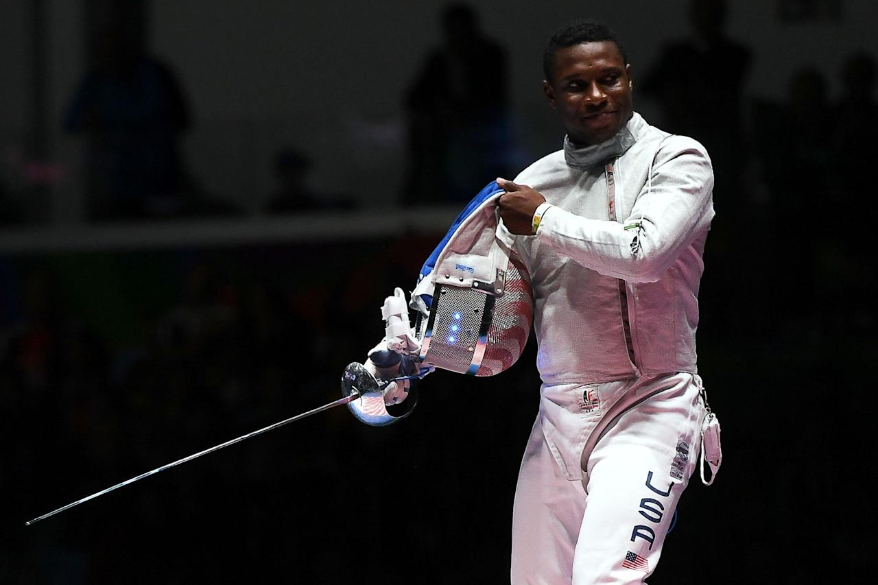 <p><strong>Silver medal</strong>, men's sabre fencing.</p>