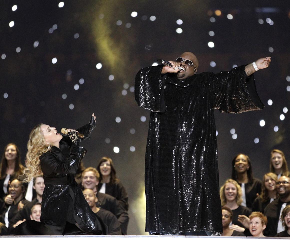 Madonna, left, and Ceelo Green perform during halftime of the NFL Super Bowl XLVI football game between the New England Patriots and the New York Giants, Sunday, Feb. 5, 2012, in Indianapolis. (AP Photo/David J. Phillip)