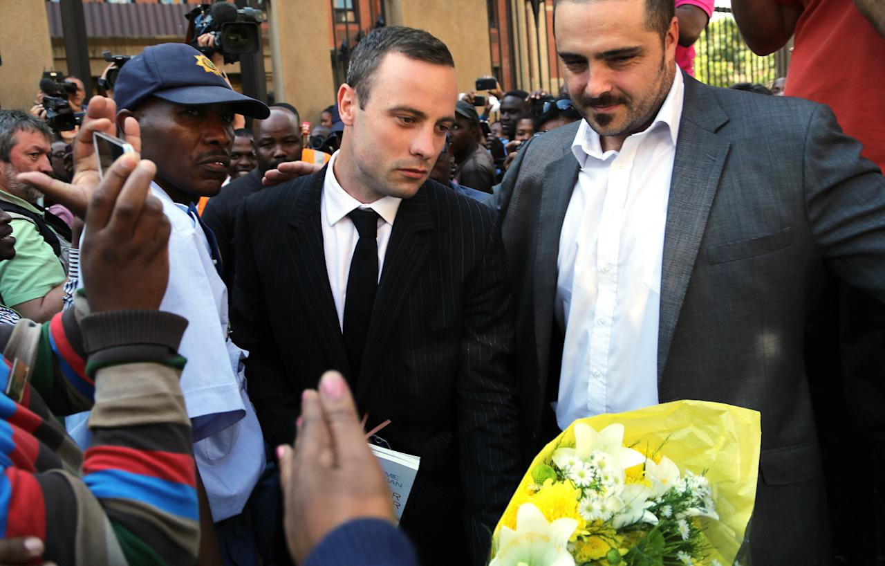 Oscar Pistorius leaves the high court in Pretoria, South Africa, Friday, April 11, 2014. Pistorius is charged with the murder of his girlfriend Reeva Steenkamp, on Valentines Day in 2013. (AP Photo/Themba Hadebe)