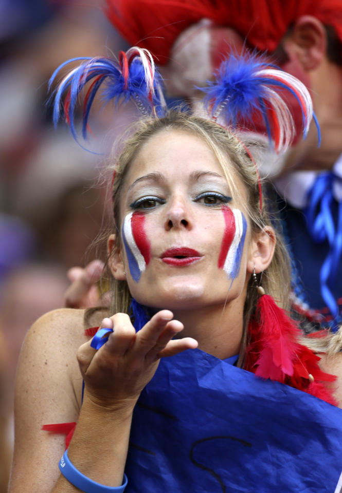 A French supporter blows a kiss before the World Cup round of 16 soccer match between France and Nigeria at the Estadio Nacional in Brasilia, Brazil, Monday, June 30, 2014. (AP Photo/David Vincent)