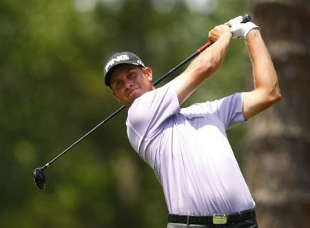 English of the U.S. tees off on the second hole during the third round of the Players Championship PGA golf tournament in Ponte Vedra Beach