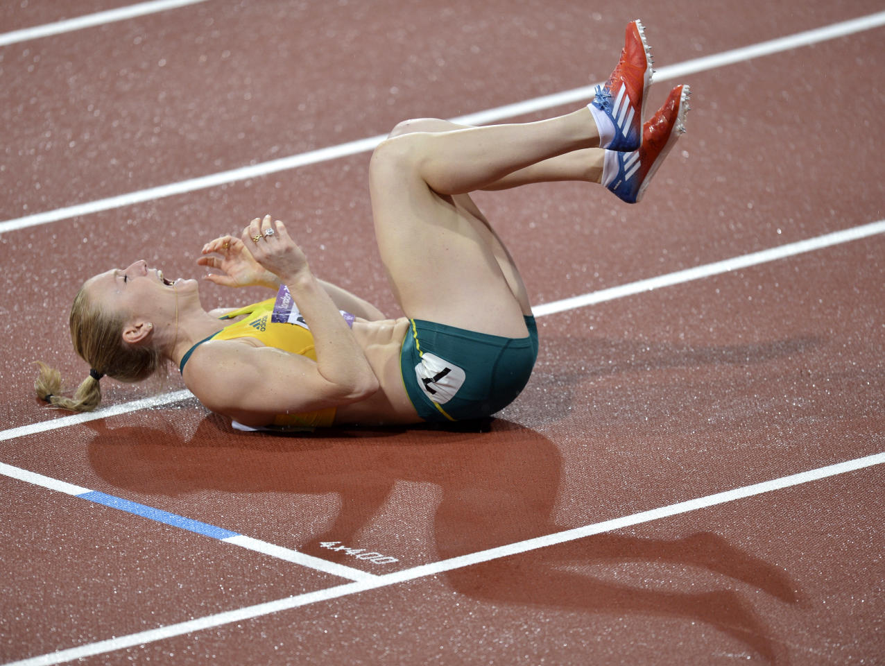 Australia's Sally Pearson celebrates after winning the women's 100-meter hurdles final during the athletics in the Olympic Stadium at the 2012 Summer Olympics, London, Tuesday, Aug. 7, 2012. (AP Photo/Martin Meissner)