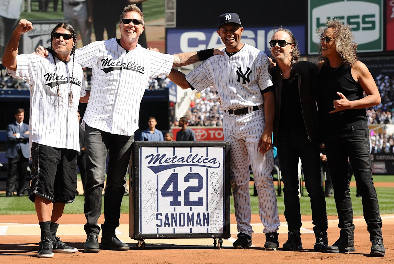 NEW YORK, NY - SEPTEMBER 22: Mariano Rivera #42 of the New York Yankees stands with Metallica, and a customized amplifier given to him by the band, during the Mariano Rivera Day pregame ceremony on September 22, 2013 at Yankee Stadium in the Bronx borough of New York City. (Photo by Maddie Meyer/Getty Images)