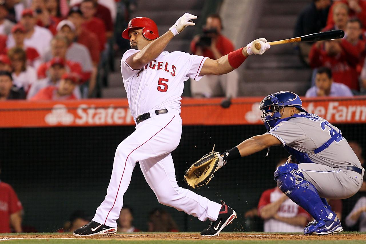 ANAHEIM, CA - APRIL 06:  Albert Pujols #5 of the Los Angeles Angels of Anaheim at bat in the first inning against the Kansas City Royals on Opening Day of the 2012 MLB season at Angel Stadium of Anaheim on April 6, 2012 in Anaheim, California. Pujols is scheduled to bat third in his debut as a member of the Angels after signing a free agent contract in the off-season.  (Photo by Jeff Gross/Getty Images)
