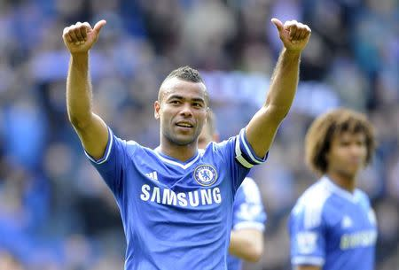 Chelsea's Ashley Cole acknowledges the Chelsea fans during their English Premier League soccer match at Cardiff City Stadium in Cardiff