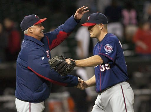 Walters throws 1st complete game for Twins