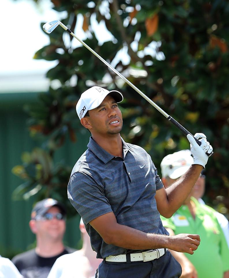 ORLANDO, FL - MARCH 24:  Tiger Woods of the USA follows his tee shot at the par 3, second hole during the third round of the 2012 Arnold Palmer Invitational presented by MasterCard at Bay Hill Club and Lodge on March 24, 2012 in Orlando, Florida.  (Photo by David Cannon/Getty Images)