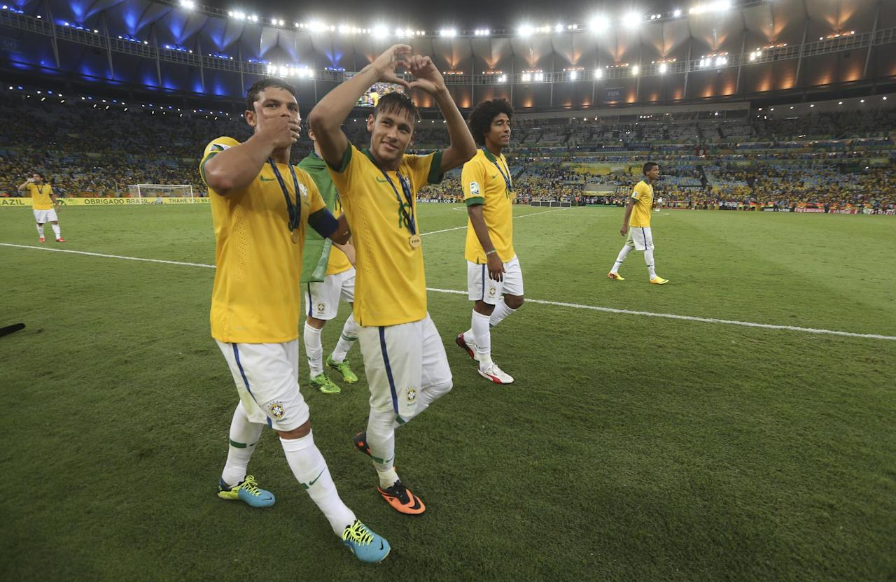 Brazil's Thiago Silva, left, Neymar and Dante celebrate after the soccer Confederations Cup final match against Spain at the Maracana stadium in Rio de Janeiro, Brazil, Sunday, June 30, 2013. Brazil won 3-0. (AP Photo/Andre Penner)