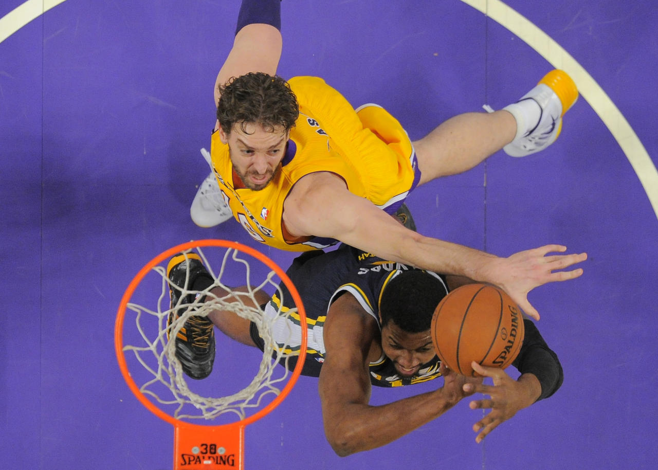 Utah Jazz forward Derrick Favors, right, puts up a shot as Los Angeles Lakers center Pau Gasol, of Spain, defends during the first half of an NBA basketball game, Friday, Jan. 3, 2014, in Los Angeles. (AP Photo/Mark J. Terrill)
