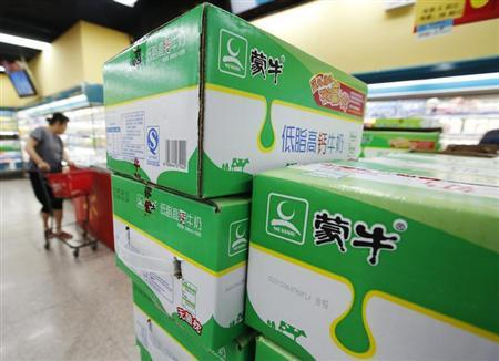 Boxes of Mengniu's milk products are seen at a supermarket in Beijing