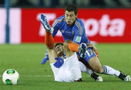 Eden Hazard of Britain's Chelsea and Jesus Corona of Mexico's Monterrey fight for the ball during their Club World Cup semi-final soccer match in Yokohama