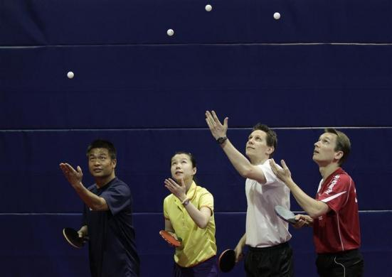 Austrian table tennis players Chen Weixing, Li Qiangbing, Robert Gardos and Werner Schlager (Left to Right) serve the ball during a training session in Schwechat outside Vienna May 2, 2012. Chen, Li, Gardos and Schleger will participate at the 2012 Olympic Games.