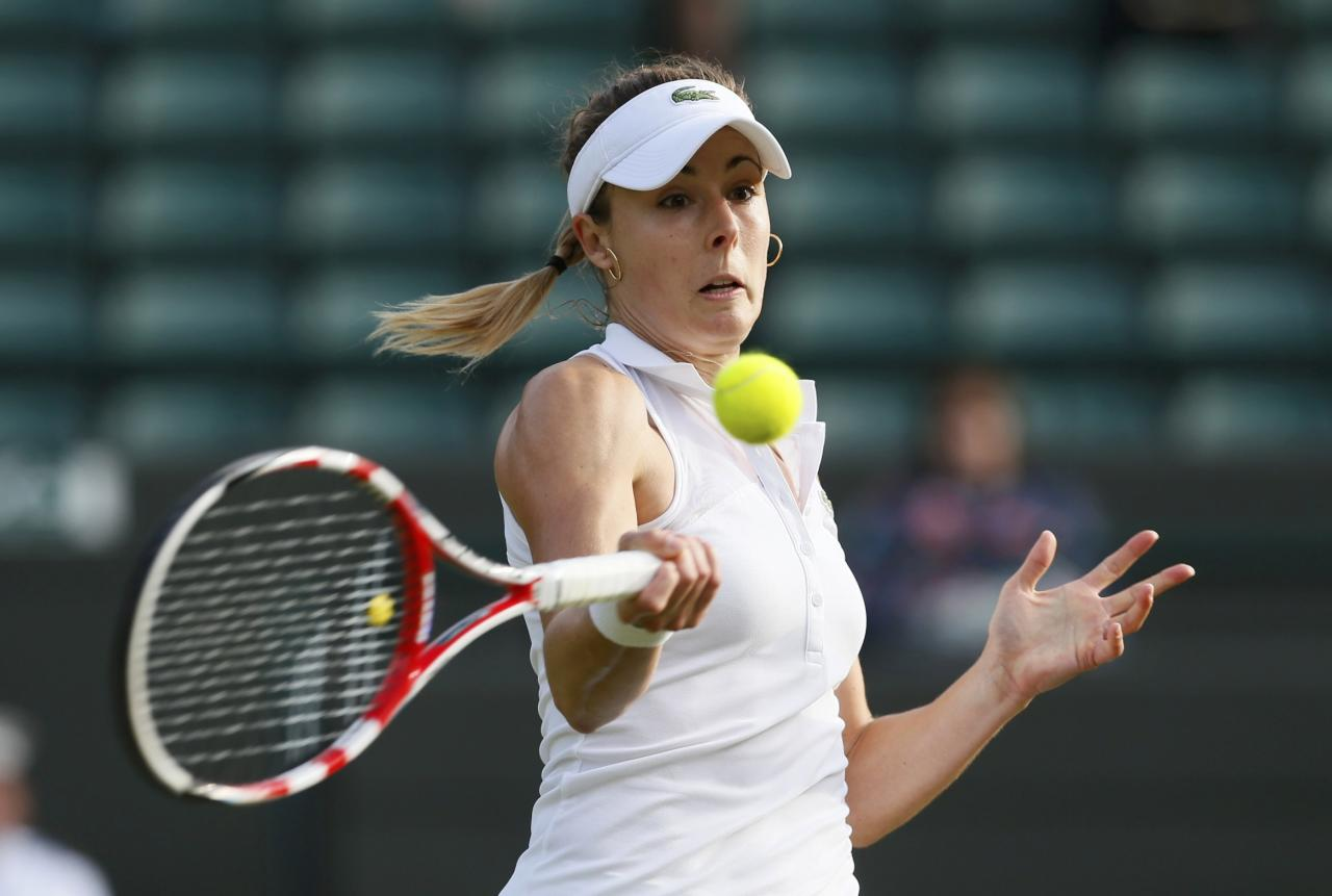 Alize Cornet of France hits a return during her women's singles tennis match against Serena Williams of the U.S. at the Wimbledon Tennis Championships, in London June 28, 2014. REUTERS/Stefan Wermuth (BRITAIN - Tags: SPORT TENNIS)