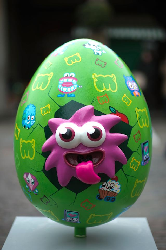LONDON, ENGLAND - MARCH 22:  One of the giant fibreglass easter eggs, entitled 'IGGY Eggy' by Moshi Monsters on display in Covent Garden before the Big Egg Hunt on March 22, 2013 in London, England. Each egg is two and a half feet tall and designed by a leading artist.  (Photo by Bethany Clarke/Getty Images)