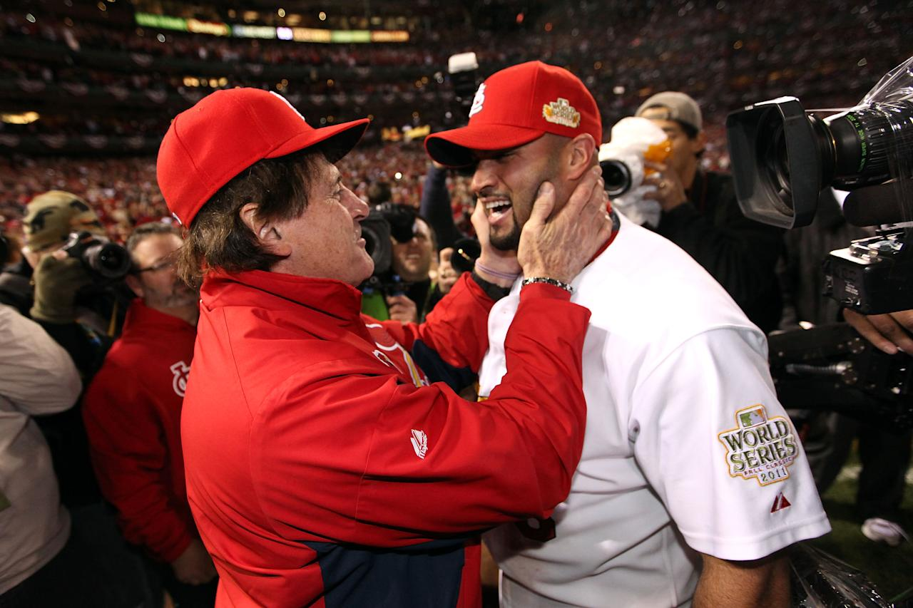 ST LOUIS, MO - OCTOBER 28:  (L-R) Manager Tony La Russa and Albert Pujols #5 of the St. Louis Cardinals celebrate after defeating the Texas Rangers 6-2 to win the World Series in Game Seven of the MLB World Series at Busch Stadium on October 28, 2011 in St Louis, Missouri.  (Photo by Jamie Squire/Getty Images)