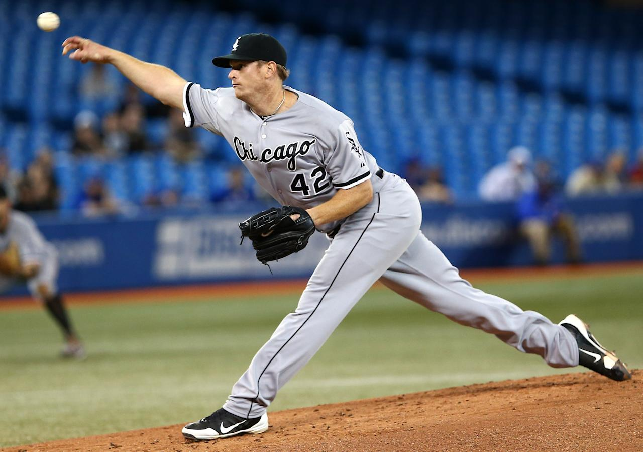 TORONTO, CANADA - APRIL 15: Gavin Floyd of the Chicago White Sox delivers a pitch during MLB game action against the Toronto Blue Jays on April 15, 2013 at Rogers Centre in Toronto, Ontario, Canada. All uniformed team members are wearing jersey number 42 in honor of Jackie Robinson Day. (Photo by Tom Szczerbowski/Getty Images)