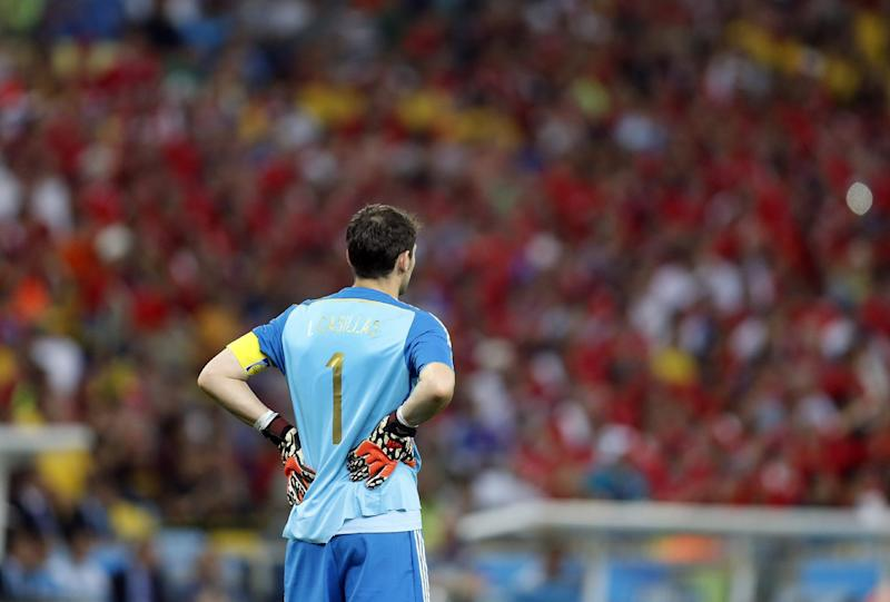 Spaniards stunned by 2-0 World Cup loss to Chile