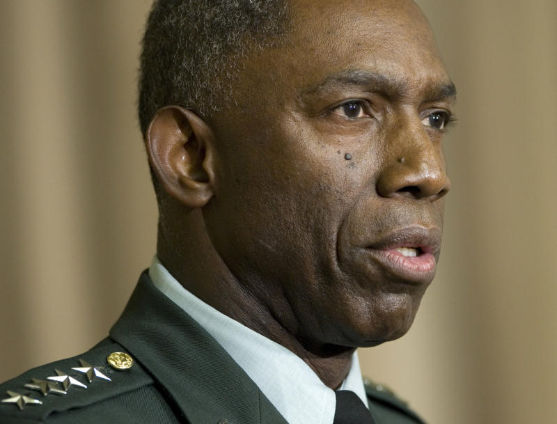 General demoted for lavish travel and spending