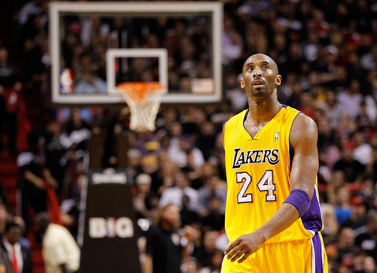MIAMI, FL - JANUARY 19:  Kobe Bryant #24 of the Los Angeles Lakers looks on during a game against the Miami Heat at American Airlines Arena on January 19, 2012 in Miami, Florida. NOTE TO USER: User expressly acknowledges and agrees that, by downloading and/or using this Photograph, User is consenting to the terms and conditions of the Getty Images License Agreement.  (Photo by Mike Ehrmann/Getty Images)
