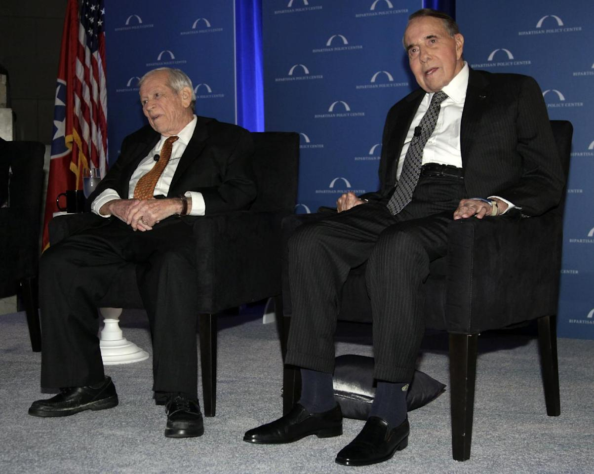 "Former U.S. Senate Majority Leaders Bob Dole, right, and Howard Baker sit next tot the stage as Vice President Joe Biden, not seen, speaks at ""A Century of Service"" honoring them at Mellon Auditorium, Wednesday, March 21, 2012, in Washington. (AP Photo/Carolyn Kaster)"