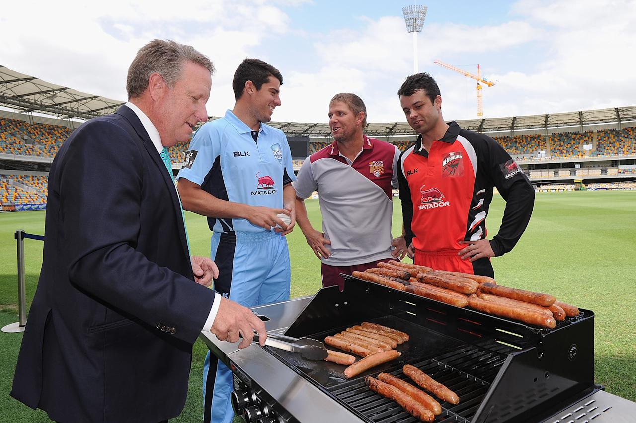 BRISBANE, AUSTRALIA - OCTOBER 02:  (L-R) Former Australian cricket player Ian Healy, Moises Henriques of New South Wales, James Hopes of Queensland and Callum Ferguson of South Australia pose during the Matador BBQs Cup series launch at The Gabba on October 2, 2014 in Brisbane, Australia.  (Photo by Matt Roberts/Getty Images)