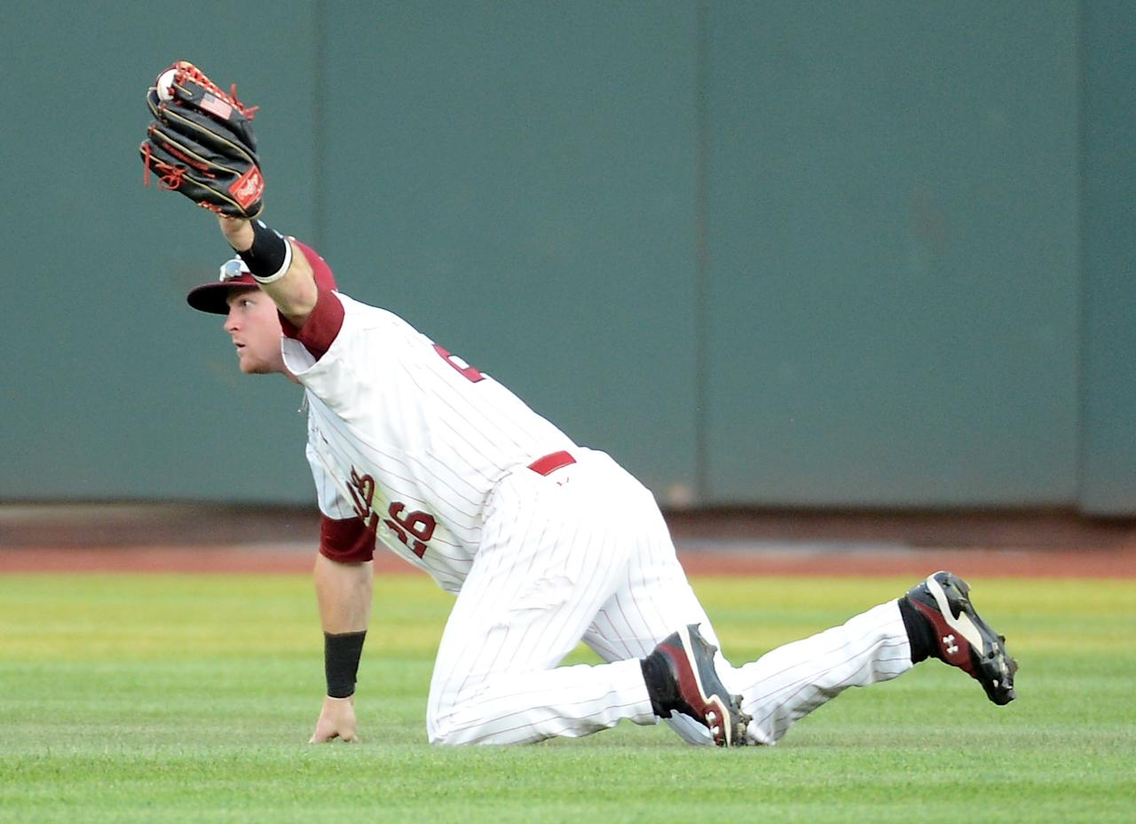 OMAHA, NE - JUNE 25:  Adam Matthews #26 of the South Carolina Gamecocks makes a catch for an out of Alex Mejia #13 of the Arizona Wildcats in the fourth inning during game 2 of the College World Series at TD Ameritrade Field on June 25, 2012 in Omaha, Nebraska.  (Photo by Harry How/Getty Images)