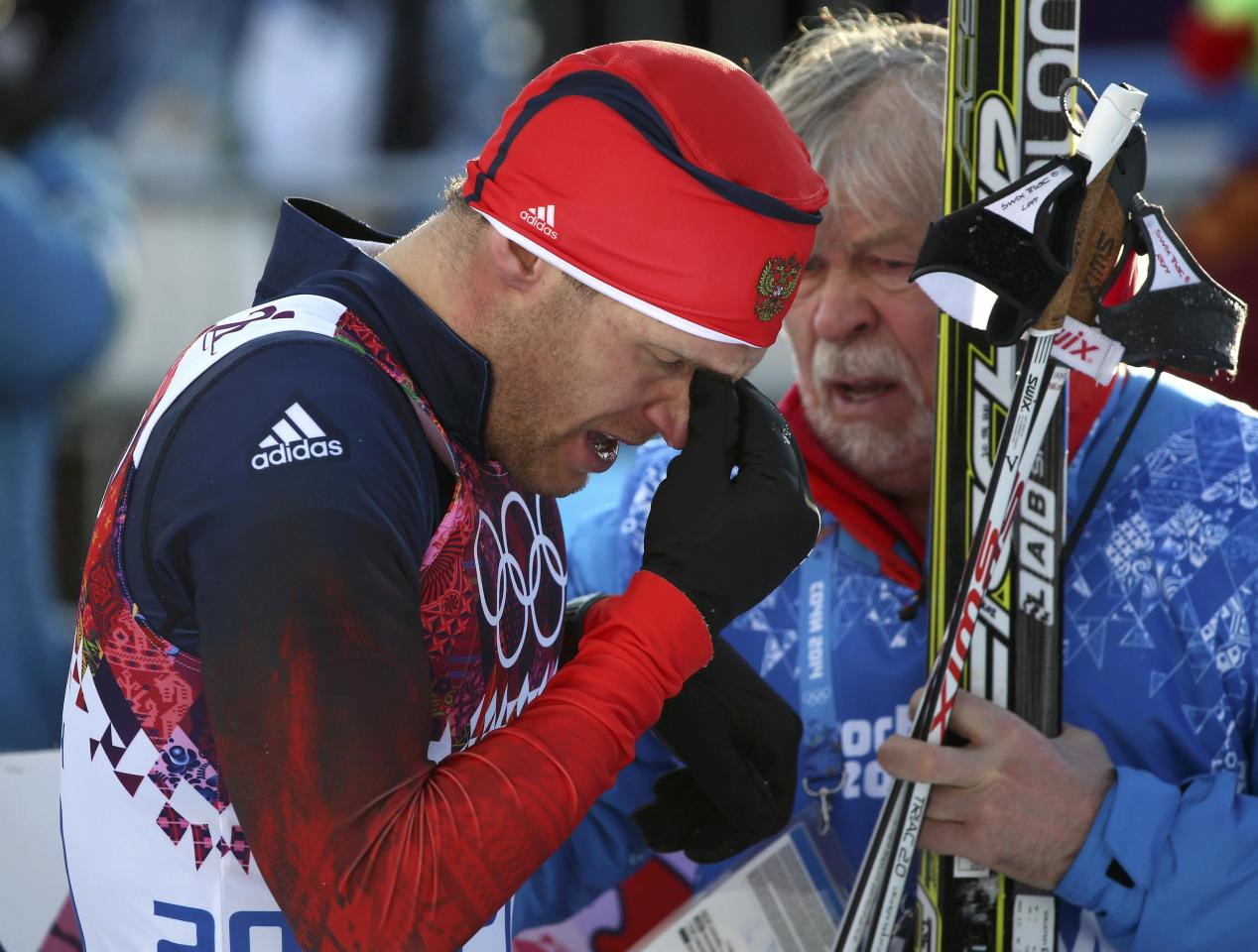 Russia's Anton Gafarov (L) reacts after failing to get through to the next stage of competition, in the men's cross-country sprint semi-final at the Sochi 2014 Winter Olympic Games in Rosa Khutor February 11, 2014. REUTERS/Sergei Karpukhin (RUSSIA - Tags: OLYMPICS SPORT SKIING)
