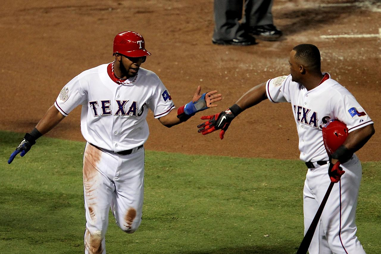 ARLINGTON, TX - OCTOBER 23:  Elvis Andrus #1 of the Texas Rangers celebrates with Adrian Beltre #29  after scoring in the first inning during Game Four of the MLB World Series against the St. Louis Cardinals at Rangers Ballpark in Arlington on October 23, 2011 in Arlington, Texas.  (Photo by Doug Pensinger/Getty Images)