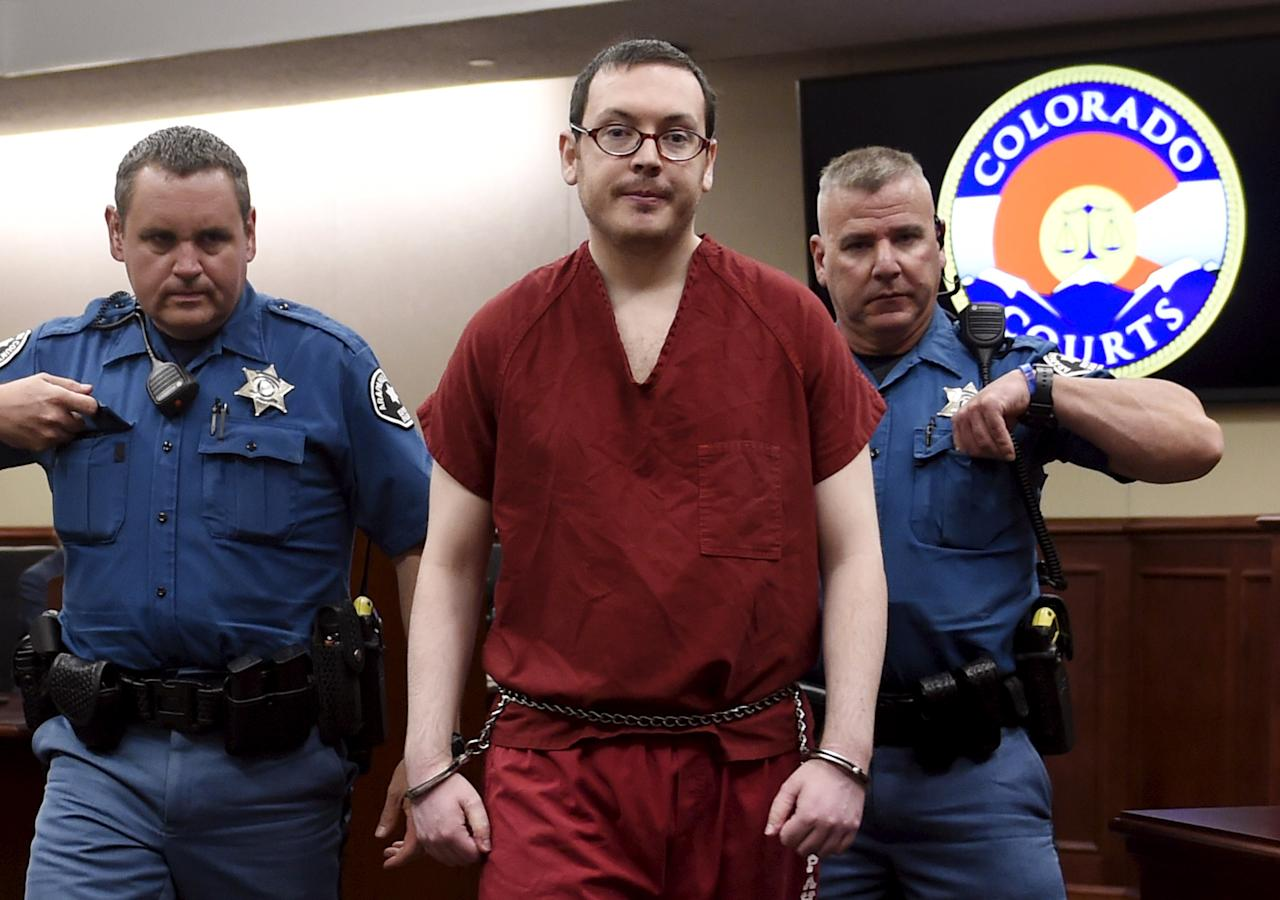 Colorado movie massacre gunman James Holmes (C) leaves court for the last time before beginning his life sentence with no chance of parole after a hearing in Centennial, Colorado August 26, 2015. The judge in the Colorado movie massacre trial will condemn Holmes to 12 life sentences and potentially thousands more years in prison on Wednesday, and is expected to address Holmes directly as the proceedings conclude. Holmes was found guilty in July of murdering 12 people and wounding 70 when he opened fire inside a packed midnight screening of a Batman film at a multiplex in the Denver suburb of Aurora.      REUTERS/RJ Sangosti/Pool