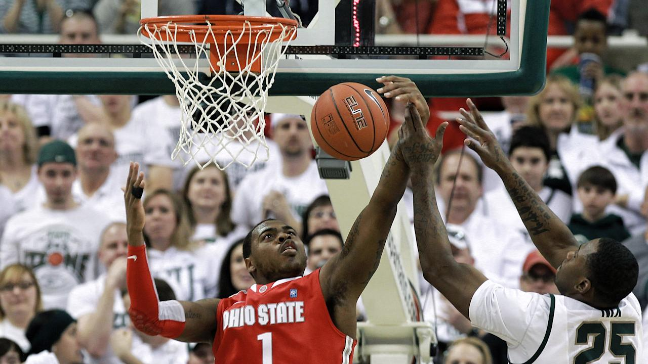 EAST LANSING, MI - MARCH 04: Deshaun Thomas #1 of The Ohio State University and Derrick Nix #25 of the Michigan State Spartans battle for the ball during the first quarter of the game at Breslin Center on March 4, 2012 in East Lansing, Michigan.  (Photo by Leon Halip/Getty Images)