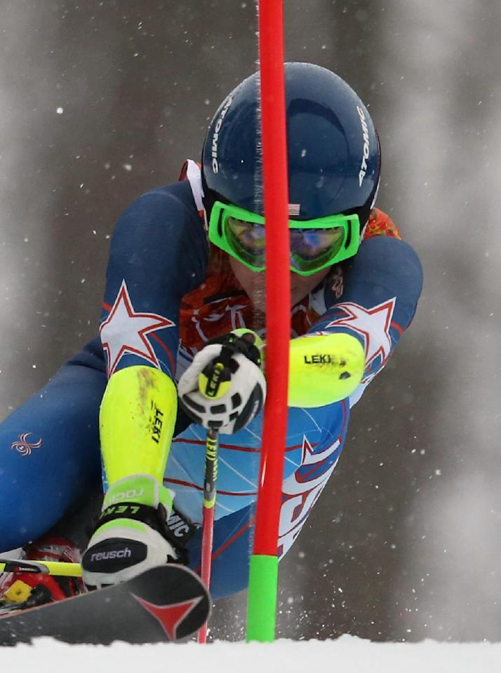 United States' Mikaela Shiffrin approaches a gate in the first run of the women's giant slalom at the Sochi 2014 Winter Olympics, Tuesday, Feb. 18, 2014, in Krasnaya Polyana, Russia.(AP Photo/Alessandro Trovati)