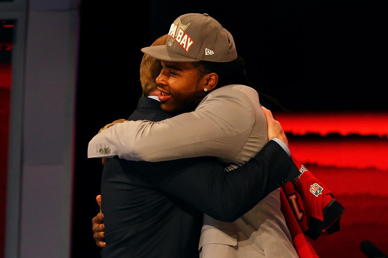 NEW YORK, NY - APRIL 26:  Mark Barron of Alabama greets NFL Commissioner Roger Goodell after he was selected #7 overall by the Tampa Bay Buccaneers in the first round of during the 2012 NFL Draft at Radio City Music Hall on April 26, 2012 in New York City.  (Photo by Al Bello/Getty Images)