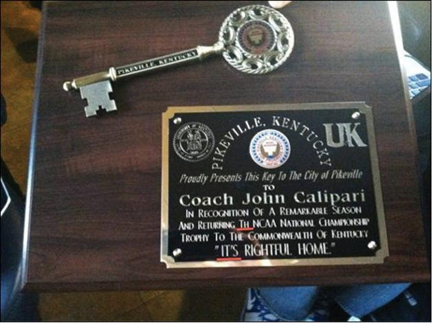 City officials in Pikeville, Kentucky, got a litle overexcited after UK brought home the 2012 NCAA championship trophy. Along with a ceremonial key to the city, they presented Kentucky coach John Calipari with this plaque, complete with two typographical errors.