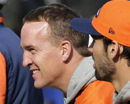 Denver Broncos Peyton Manning looks over filed as they visit Met Life Stadium before Super Bowl in East Rutherford
