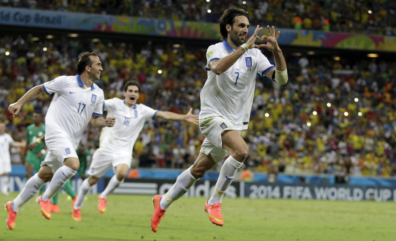 Greece's Giorgos Samaras celebrates scoring his side's 2nd goal from the penalty spot during the group C World Cup soccer match between Greece and Ivory Coast at the Arena Castelao in Fortaleza, Brazil, Tuesday, June 24, 2014. (AP Photo/Natacha Pisarenko)