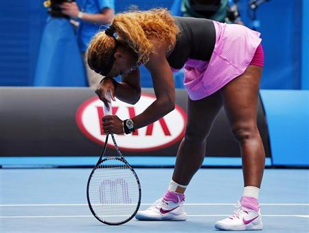 Serena Williams of the U.S. leans on her racquet during her women's singles match against Ana Ivanovic of Serbia at the Australian Open 2014 tennis tournament in Melbourne