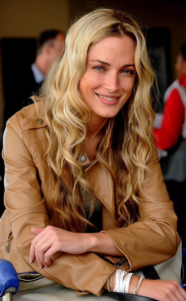 <p>Steenkamp and Pistorius had been together for several months. Pistorius, the face of Paralympian sport, made history in 2012 when he competed in both the Paralympic and Olympic Games (Gallo Images / Rex Features)</p>