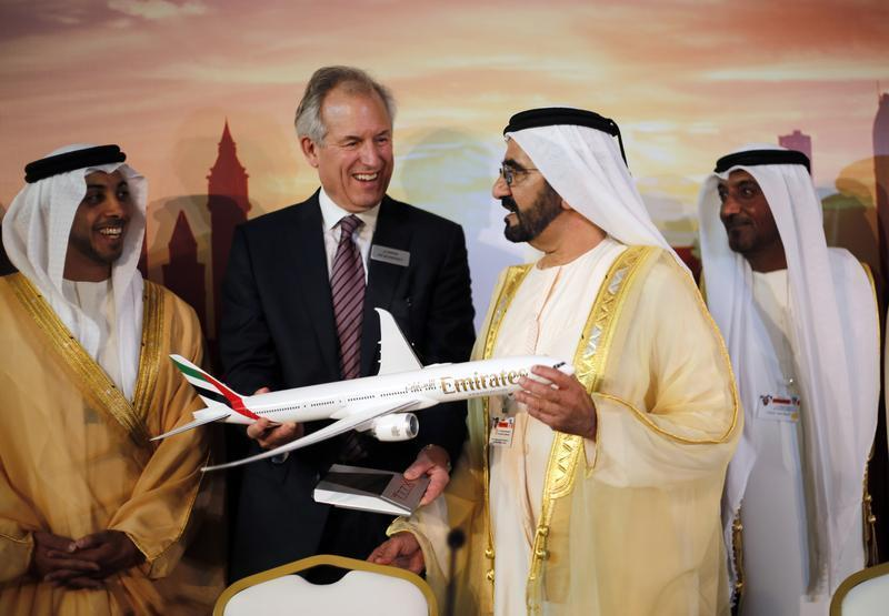 Boeing Chairman McNerney shows United Arab Emirates' PM and Ruler of Dubai Sheikh Mohammed a model of new version of its 777 long-haul jet during Dubai Airshow