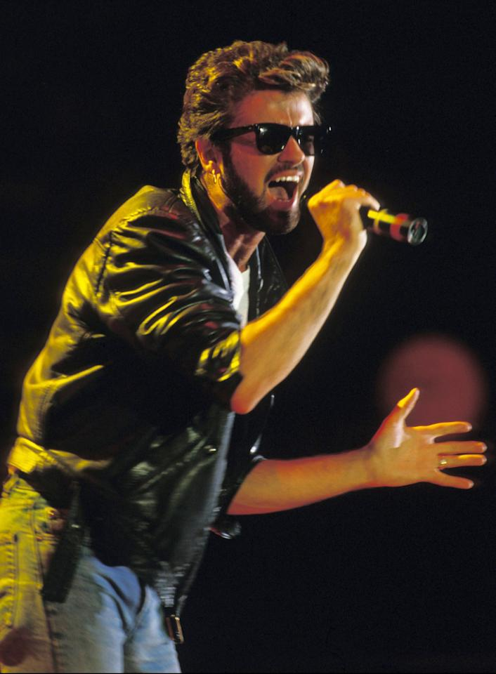 THEN: George Michael sings during Live Aid in Wembley stadium 13 July 2004. (Photo by Georges DeKeerle/Getty Images)