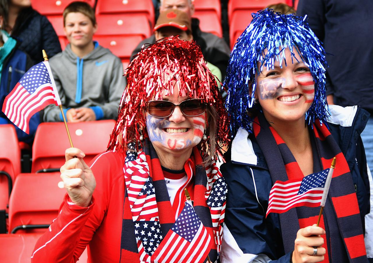 GLASGOW, SCOTLAND - JULY 28:  USA fans smile during the Women's Football first round Group G match between United States and Colombia on Day 1 of the London 2012 Olympic Games at Hampden Park on July 28, 2012 in Glasgow, Scotland.  (Photo by Stanley Chou/Getty Images)