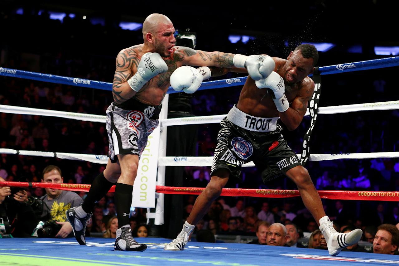 NEW YORK, NY - DECEMBER 01:  Austin Trout (R) catches a punch to the face thrown by Miguel Cotto in their WBA Super Welterweight Championship title fight at Madison Square Garden on December 1, 2012 in New York City.  (Photo by Elsa/Getty Images)