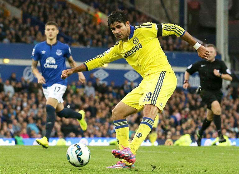 Chelsea's Diego Costa scores his team's sixth goal during their Premier League match against Everton at Goodison Park on August 30, 2014
