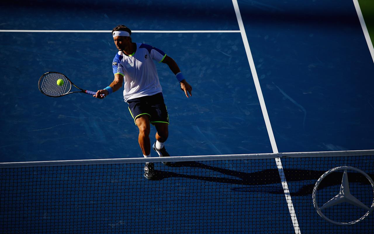 NEW YORK, NY - SEPTEMBER 04: David Ferrer of Spain plays a forehand during his men's singles quarter-final match against Richard Gasquet of France on Day Ten of the 2013 US Open at the USTA Billie Jean King National Tennis Center on September 4, 2013 in New York City. (Photo by Joe Scarnici/Getty Images)