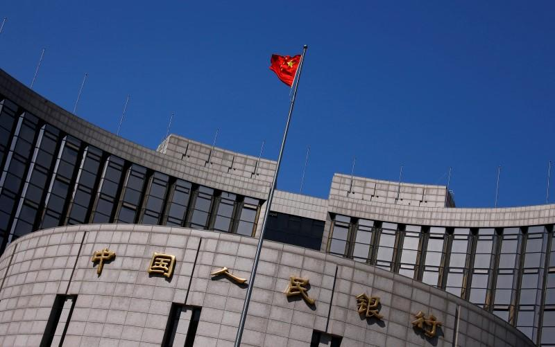 China currency reserves fall back from May's rebound