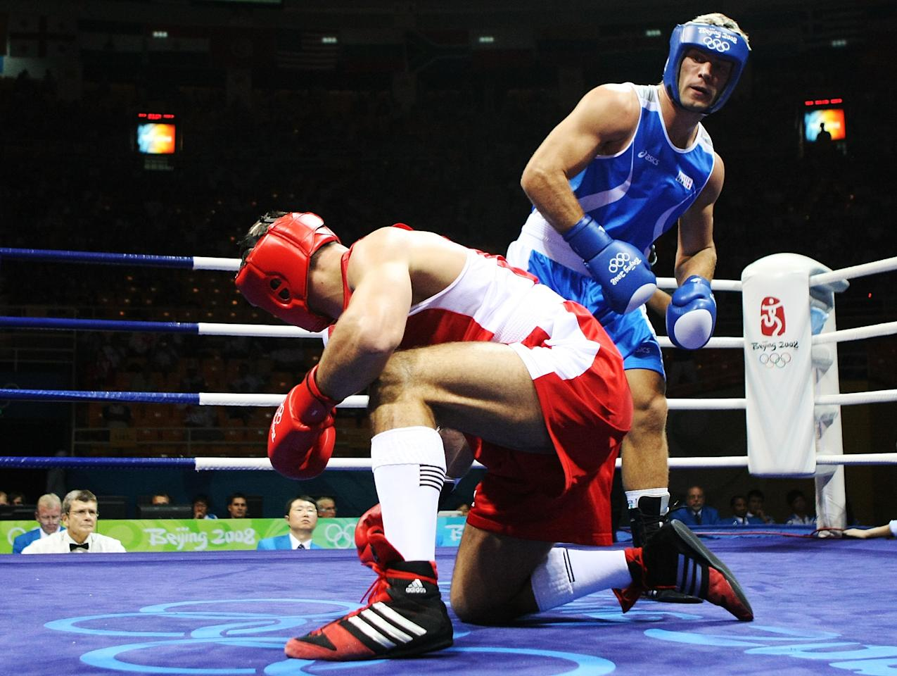 BEIJING - AUGUST 23:  Rakhim Chakhkiev of Russia (red) competes against Clemente Russo of Italy (blue) in the Men's Heavy (91kg) Final Bout held at Workers' Indoor Arena on Day 15 of the Beijing 2008 Olympic Games on August 23, 2008 in Beijing, China.  (Photo by Nick Laham/Getty Images)
